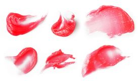 Lip balm. Red lip balm texture pieces Stock Image