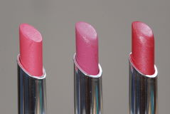 Lip Colors. Three lip colors from same color family Stock Images