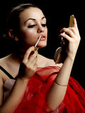 Lip Gloss. Fashion Model with Lip Gloss and Hand Mirror stock image