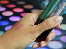 Lip Gloss. Glitter makeup stylist in his hand Stock Photos