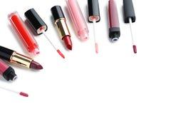 Lip gloss and lipsticks Stock Photos