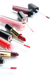 Lip gloss and lipsticks Royalty Free Stock Photo