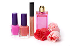 Lip gloss, perfume, nail polish bottles Stock Photos