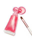 Lip gloss pink color and brush from tube on white background Royalty Free Stock Image