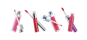 Lip glosses. Isolated on white background Stock Photography