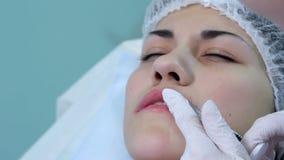 Lip injection plastic surgery. Closeup upper lip stock video footage