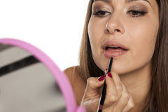 Lip liner apply Royalty Free Stock Image