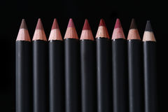 Lip Liner Pencils on Black Background. Black Lip Liner Pencils on Black Background stock image