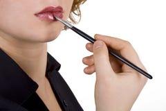 Lip makeup applying Stock Images