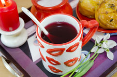 Lip patterned cup of tea on a tray Stock Images