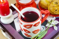 Lip patterned tea mug and corn bread closeup Royalty Free Stock Photos