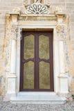 Bronze door to the Basilica San Bartolomeo in Lipari. Lipari, Aeolian Islands, Italy - August 22, 2017: Reliefs on the main entrance to the Basilica San Stock Photo