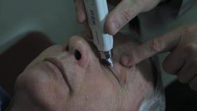 Lipetsk, Federação Russa - 15 de março de 2015: Dia dos olhos saudáveis na clínica 9, optometrista do doutor vídeos de arquivo