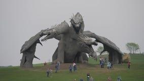 LIPETSK REGION, RUSSIA - MAY 10, 2019: Family Ethnic Amusement Park Kudykina Gora. Monument of Russian fairytale three. Headed dragon Zmey Gorynych. Way to stock video footage