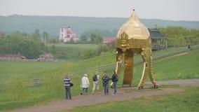 LIPETSK REGION, RUSSIA - MAY 10, 2019: Family Ethnic Amusement Park Kudykina Gora. Monument of Russian fairytale three. Headed dragon Zmey Gorynych. Way to stock footage