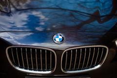 Lipetsk, Russia - 25 april 2015: BMW . BMW German beast. Black BMW, car hood, car logo. Lipetsk, Russia - 25 april 2015 BMW car logo Stock Images