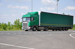 LIPETSK, RUSSIA - 29.05. 2015. Green Scania semi-trailer truck at  interurban road Stock Photography