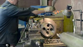 Turning works. The turner makes a metal part on a mechanical lathe. LIPETSK, RUSSIA - JUNE 15, 2017: Lipetsk Machine Tool Plant, Turning works. The turner makes stock video
