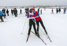 02/09/2019 Lipetsk, Russian Ski Track. Two skiers athletes hug after the finish royalty free stock images
