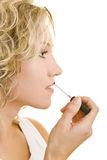 Lipgloss auf den Lippen Stockfotografie