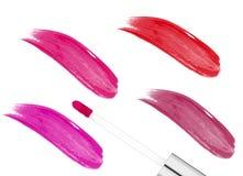 Lipgloss cor-de-rosa isolados no branco fotografia de stock royalty free