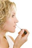 Lipgloss op de lippen Stock Fotografie
