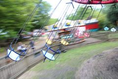 Old steam driven fairground attraction. Liphook, UK - 13 May, 2018: Old steam driven fairground attraction at the Hollycombe Steam Fair. One of several restored Stock Photography
