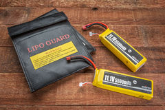 LiPO batterires with protective charging bags Royalty Free Stock Images