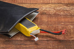 LiPO battery in protective charging bag Royalty Free Stock Images