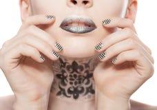 Lippen en manicure Royalty-vrije Stock Afbeeldingen