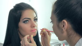 Lippenmake-up Maskenbildner stock footage