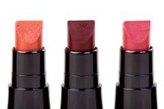 Lippenstift drei stellte in eine Reihe ein Lizenzfreies Stockbild
