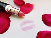 Lippenstift en kus Stock Afbeelding