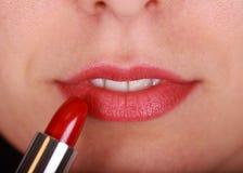 Lippenstift en lip Stock Foto's