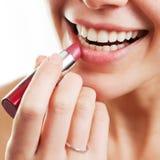 Lippenstift- und Fraulippen Stockbild