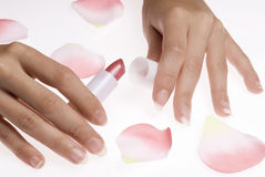 Lippenstift van de vinger en nam toe stock fotografie