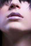 Lips. Close-up of a girl whit glossy lips, focus on lips Stock Photos