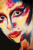 Lips of beautiful young girl with paint on his face Royalty Free Stock Photography