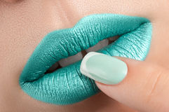 Lips close-up and manicure. Stock Images