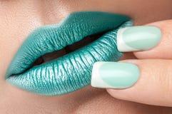 Lips close-up and manicure. Stock Photo