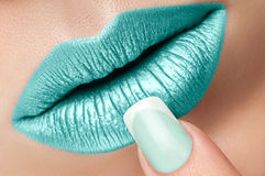 Lips close-up and manicure. Royalty Free Stock Image