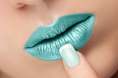 Lips close-up and manicure. Stock Image
