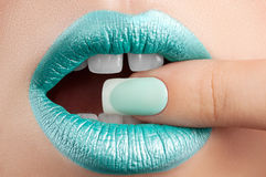 Lips close-up and manicure. Stock Photography