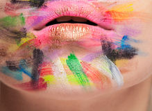 Lips in close up photo with colors on face Stock Photo