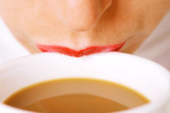 Lips on cup of coffee with milk Royalty Free Stock Image