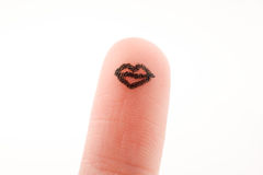 Lips drawn on a finger tip Royalty Free Stock Photo