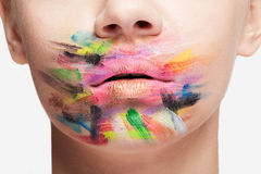 Lips and face of woman in close up with colors all over Stock Images