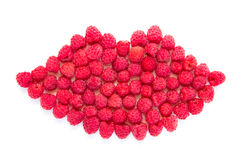 Lips in the form of raspberries. Lips are lined with juicy raspberries. Object on white background. View from above Royalty Free Stock Image