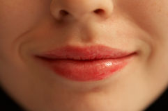 Lips of the girl. Lips of the woman Stock Image