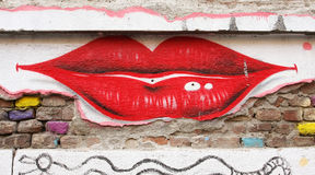 Lips graffiti. On a old building. The local authorities allowed a group of artists to paint an old central building in Timisoara, Romania